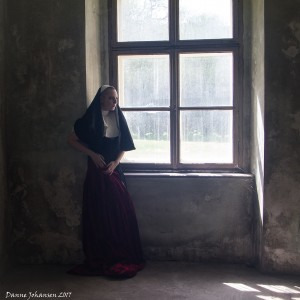 Nun in window I
